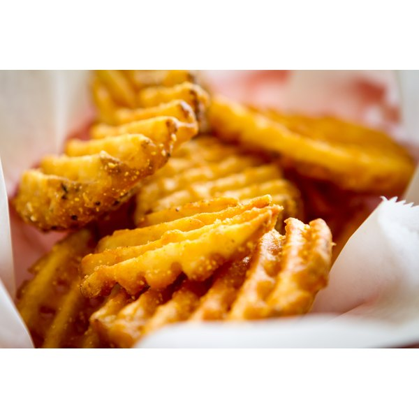 A close-up of waffle fries in a basket.