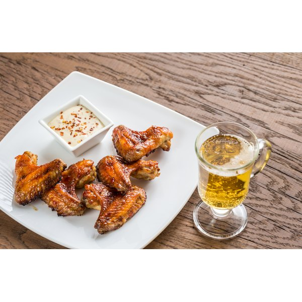 Smoked chicken wings on a white plate.
