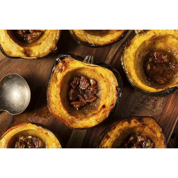 Homemade roasted acorn squash with brown sugar and pecans.