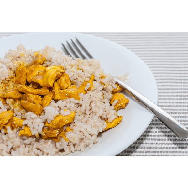 A meal of brown rice and chicken.