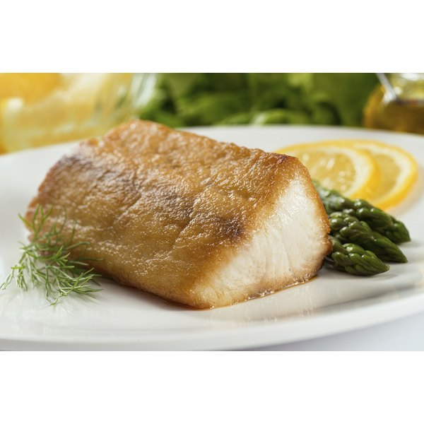 A white fish fillet on a plate.