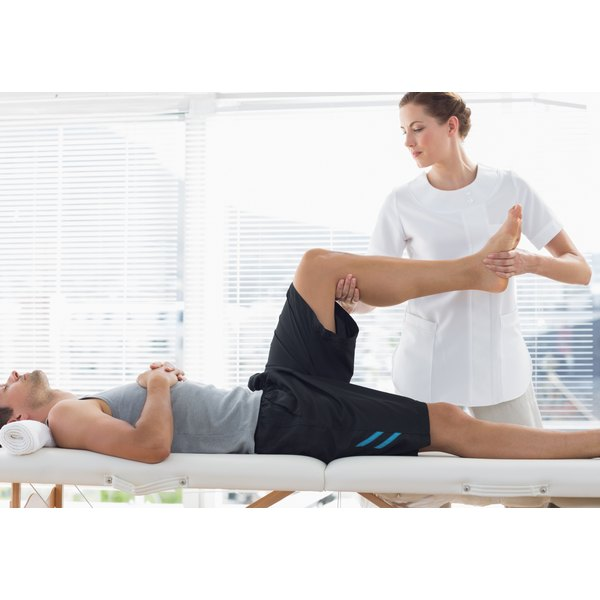 Physiotherapist working with patient.