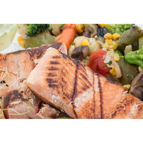 A close-up of grilled salmon and vegetables.