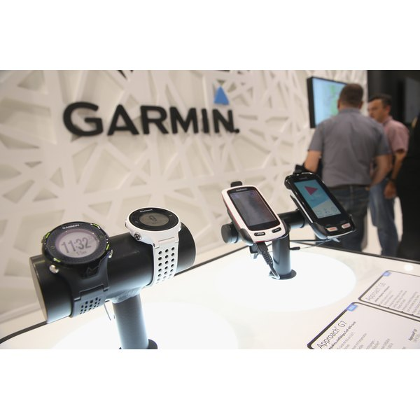 Garmin watches and GSP devices on display at a trade fair.
