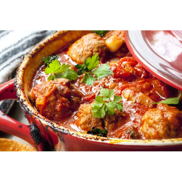 Close-up of meatballs and sauce in a crock pot.