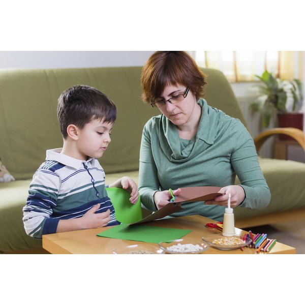 Young child working on craft with mother