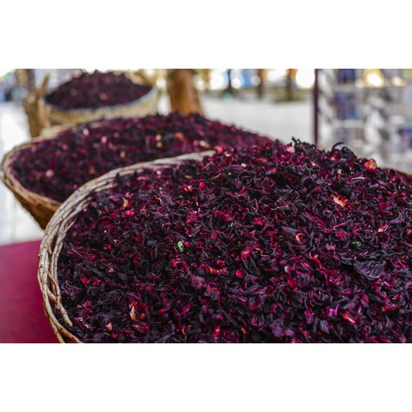 Dried hibiscus flowers for sale at a market.