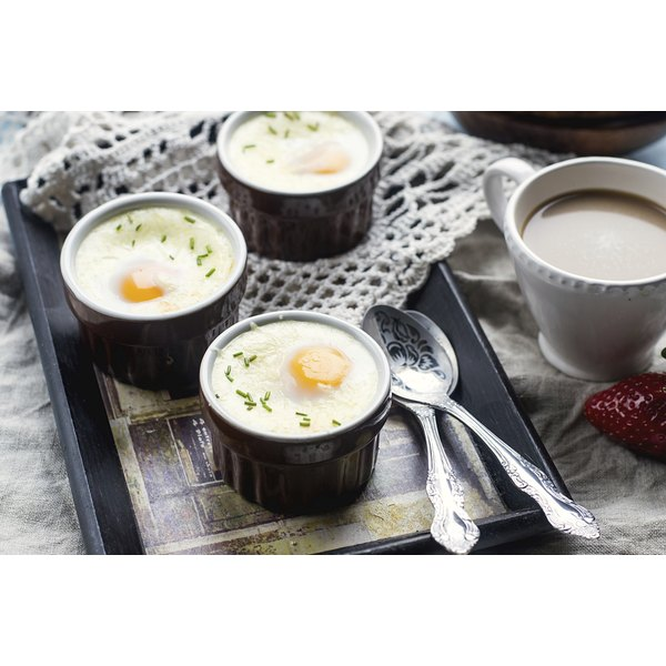Cooked eggs in custard cups.