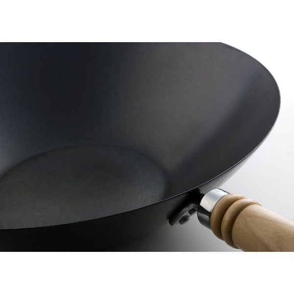 Woks with wood handles are the lightest and easiest to work with.