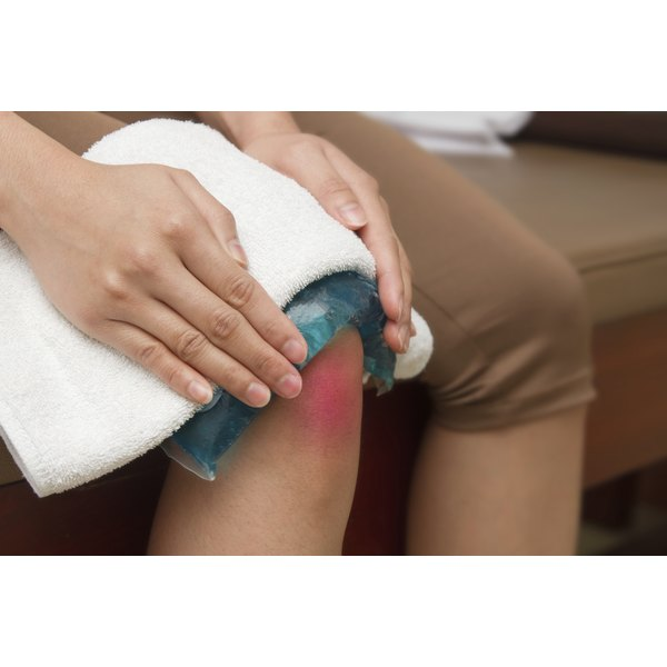 A woman applying cold pack to inflamed knee.