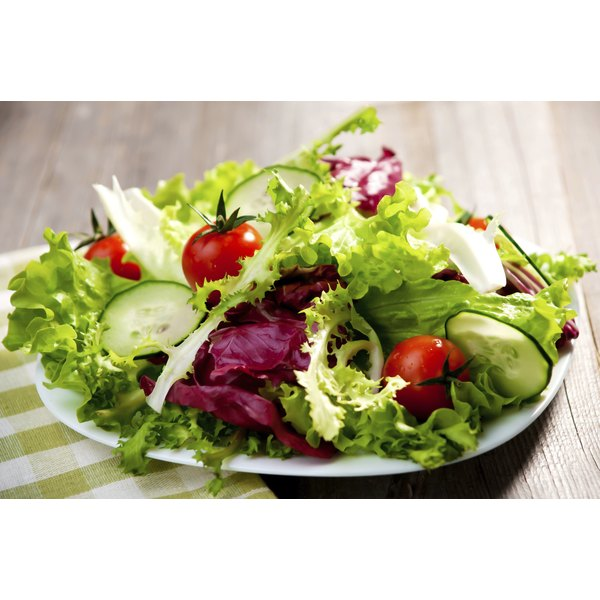 A healthy green salad on a plate.