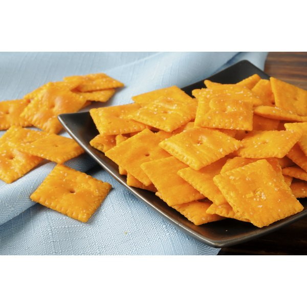 Cheese-it crackers on a plate.