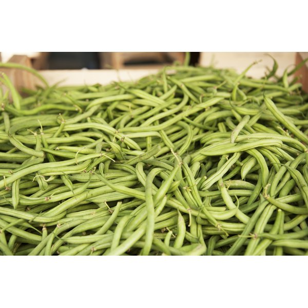 String beans for sale at a market.