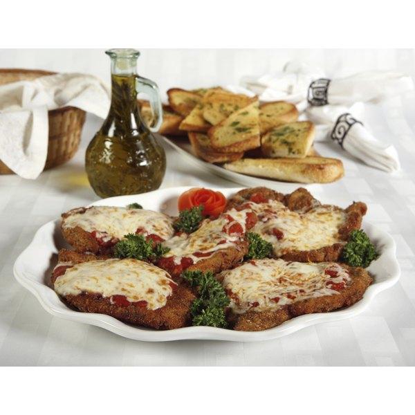 Chicken Parmesan cutlets with garlic bread.