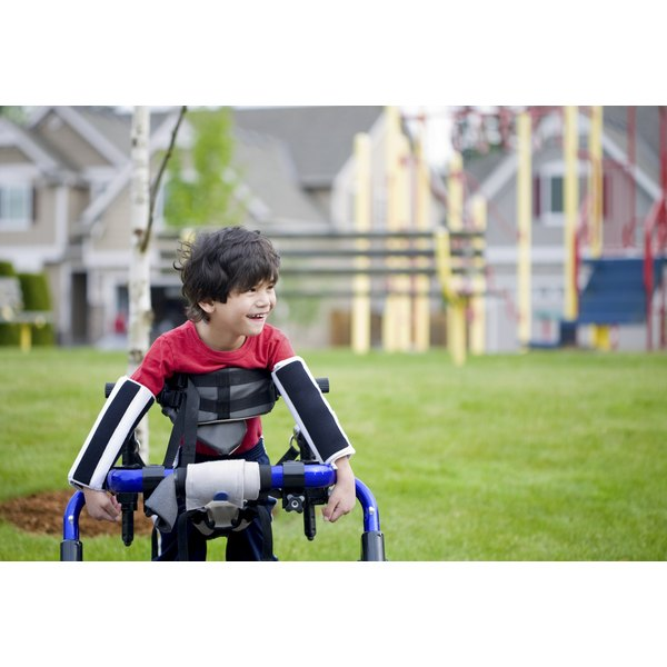 A disabled boy is using a walker.