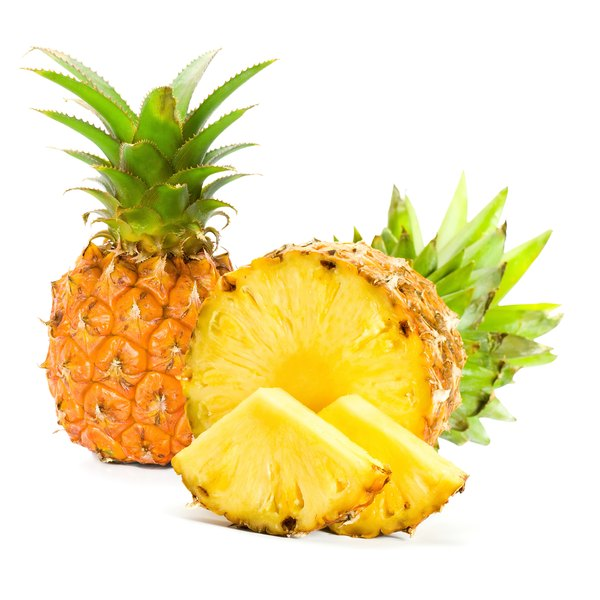 Fresh pineapple whole and cut on white background.