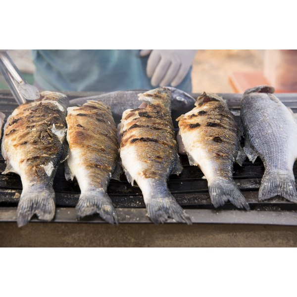 Five perch fish on the grill.