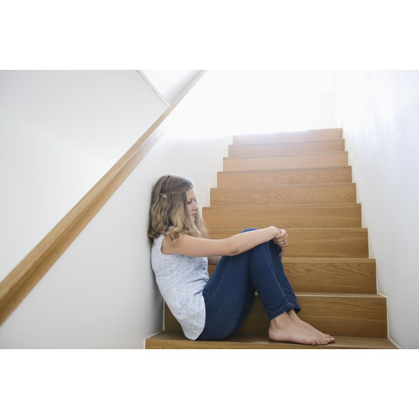 Child sitting on stairwell.