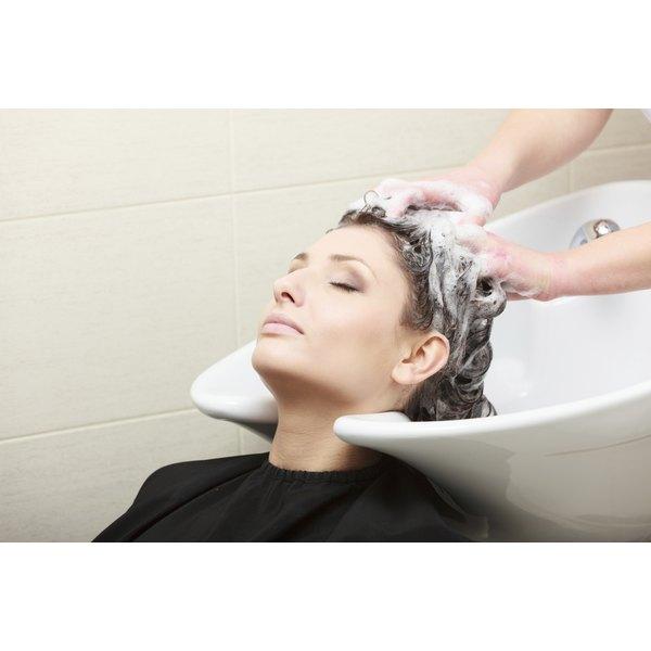Woman having her hair shampooed.