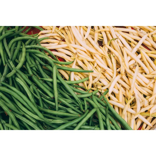 Green and yellow beans for sale at a market.