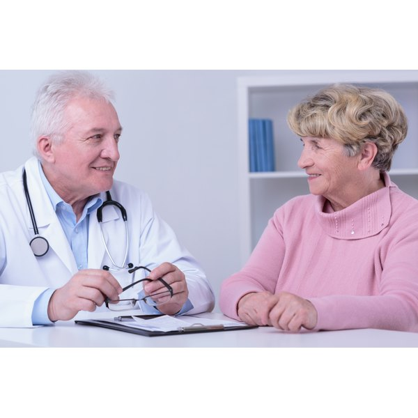 Senior woman with doctor in office.