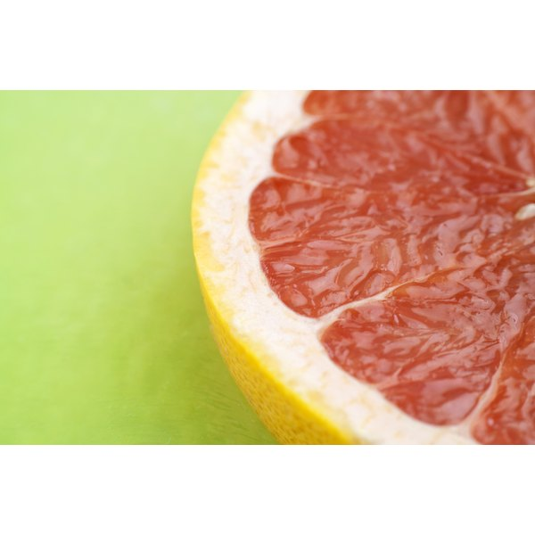 A close-up of a grapefruit on a green table.