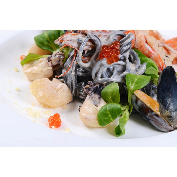Mussels and clams on pasta.