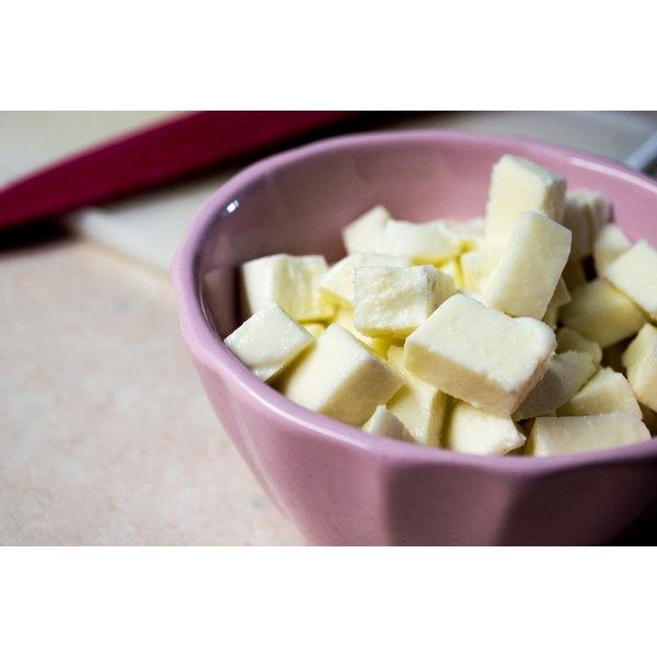 A bowl of cubed mozzarella cheese.