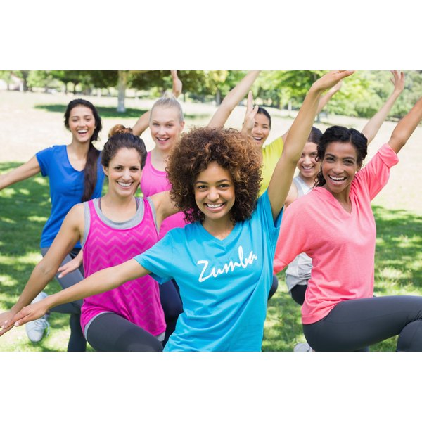 A group of people in an outdoor zumba class.