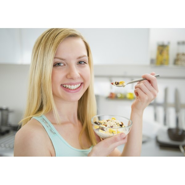 Young woman eating a healthy cereal.