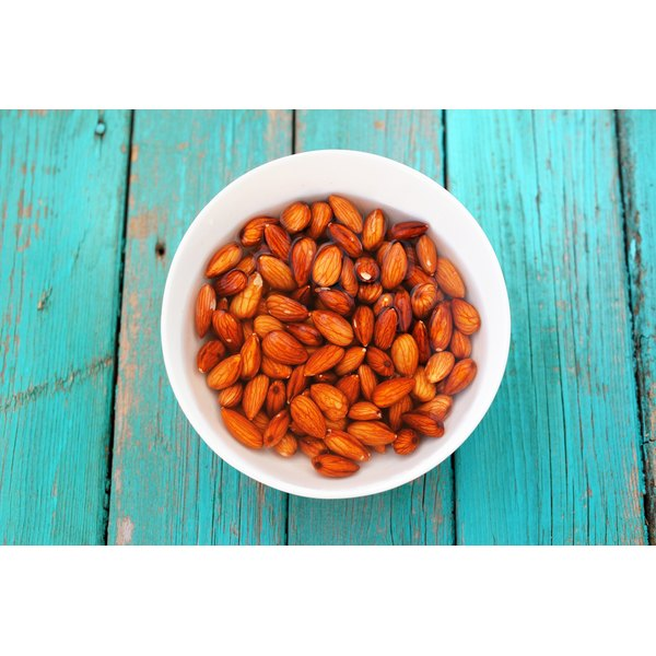 A large bowl of raw almonds.