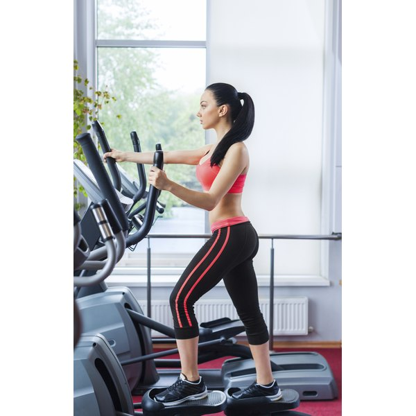 A woman exercises on a TreadClimber machine.