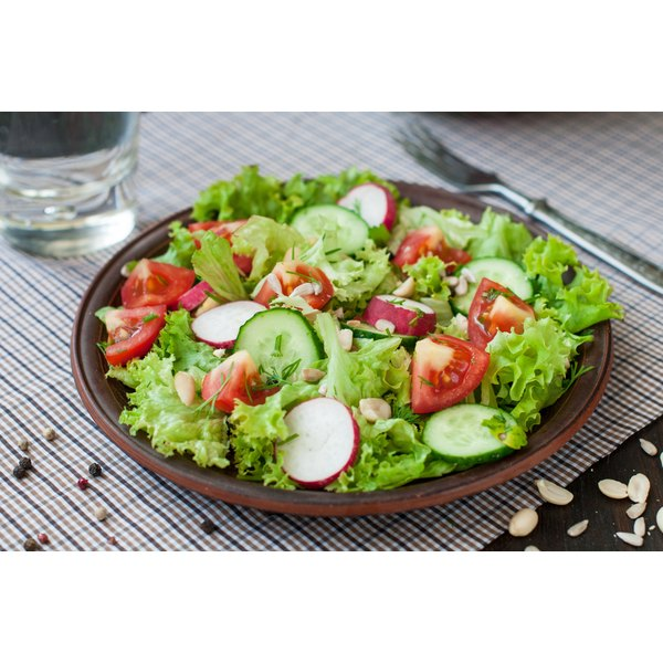 A salad with tomatoes and cucumbers.