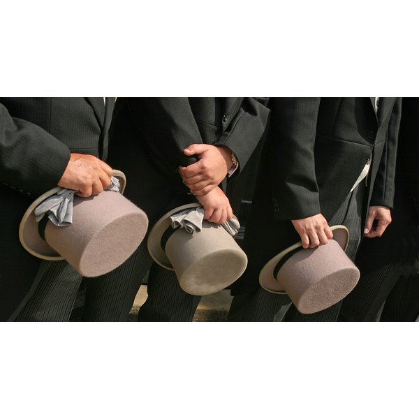 The usher's apparel meshes with the style and color of the wedding party's attire.