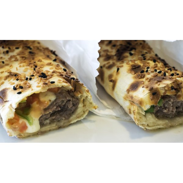 Beef gyros wrapped in paper.