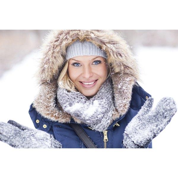 Woman outside wearing a down coat.
