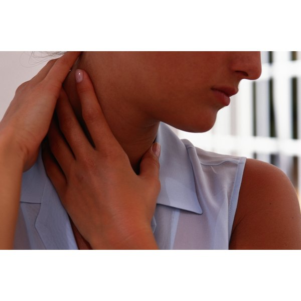 A woman massaging her neck.