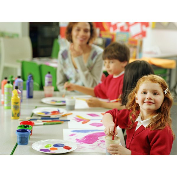 Children painting in a daycare center.