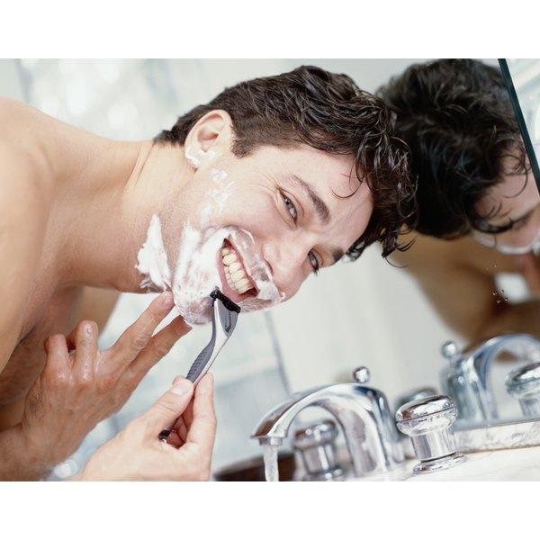 Man shaving over the sink