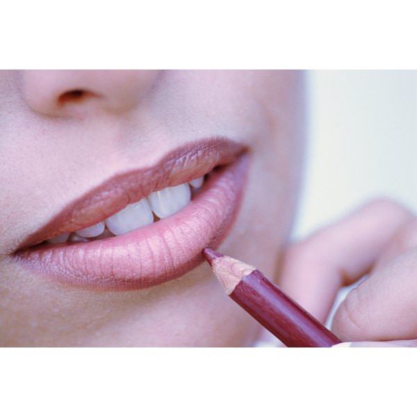 Start with lip liner to make lips appear fuller.