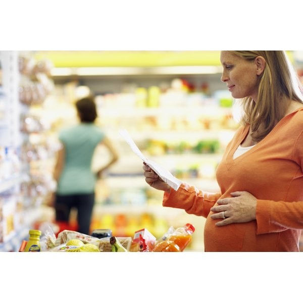 Pregnant woman shopping for food.