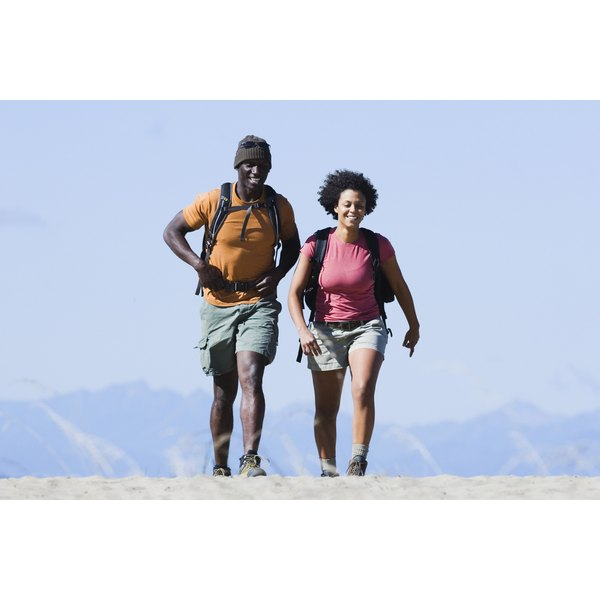 A man and woman are hiking together.