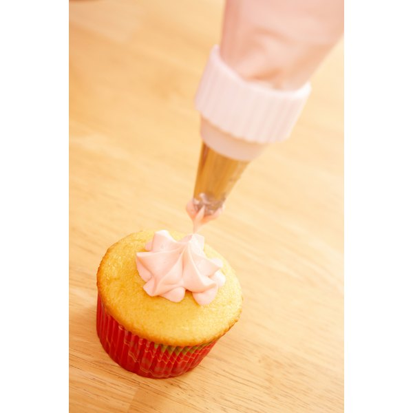 Pastry bags fitted with pastry tips provide the control needed to perfect professional-looking cupcake decorations.