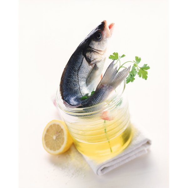 Lemon juice and fish oil both provide health benefits, but are not dependent on one another.