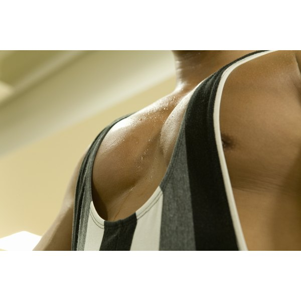 A close-up of a man's chest muscles during a work-out at the gym.
