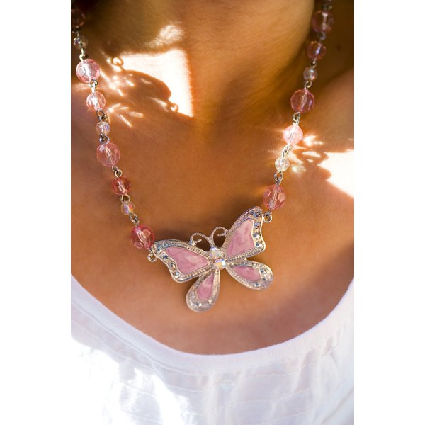 A costume jewelry butterfly necklace with rhinestones, crystals and enamel.