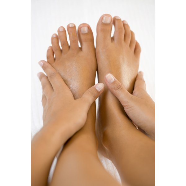 Foot swelling is typically caused by retention of water.