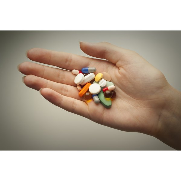 Handful of vitamins and pills