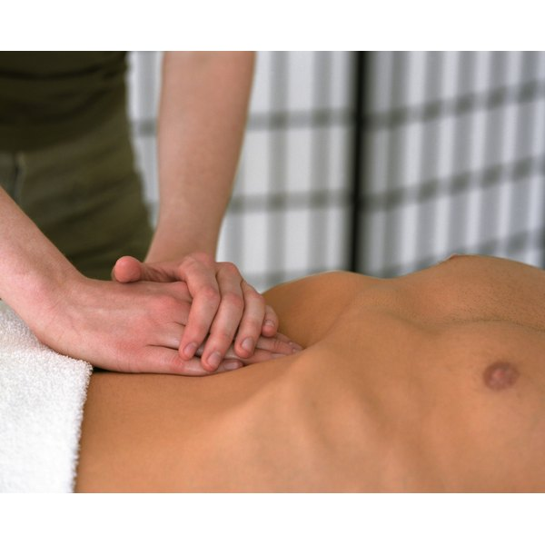 Man receiving an abdominal massage.