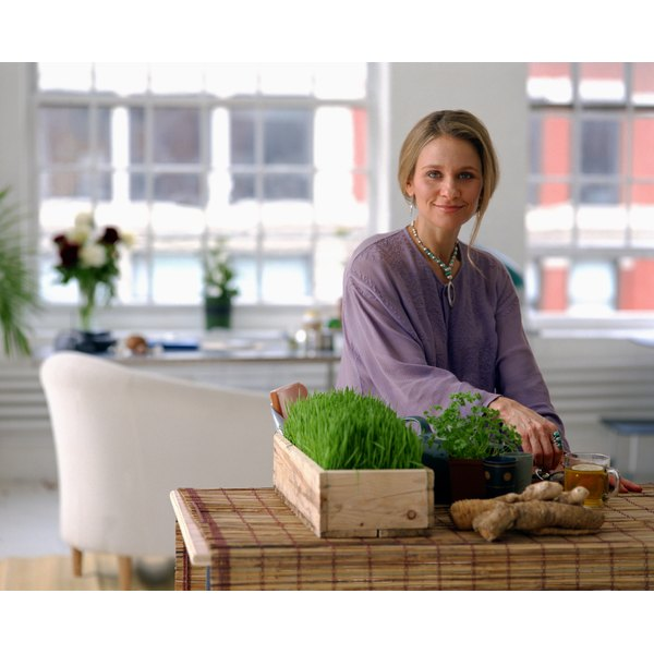 Woman with natural remedies including herbs.
